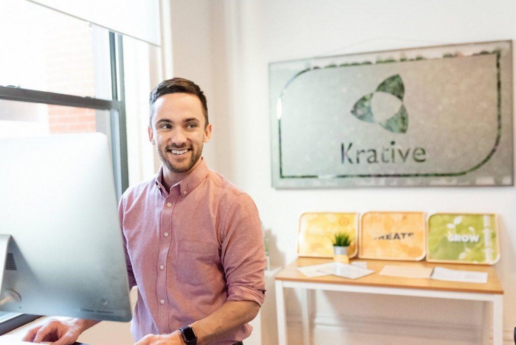 Rick Callahan of Krative standing at his computer